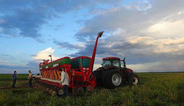Tractor preparing soy bean field in the cerrado